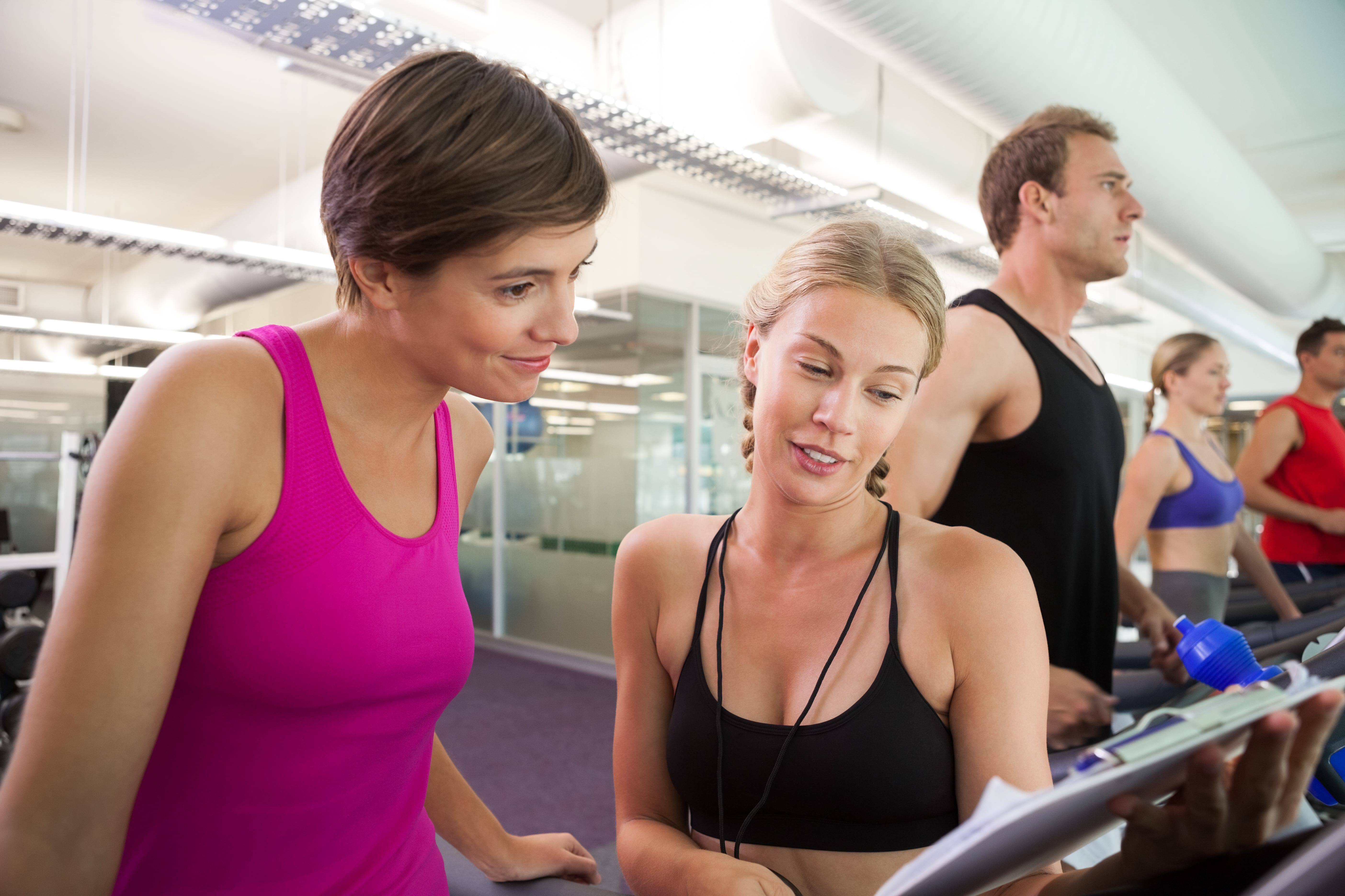 Personal trainer giving advice to client