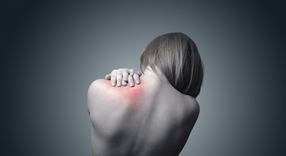 Woman with pain in her neck and shoulder