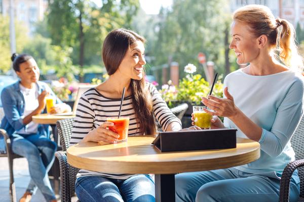 two women talking outside, networking